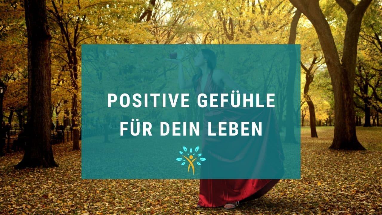 Schriftzug Positive Gefühle und eine Frau im roten Kleid im Hintergrund